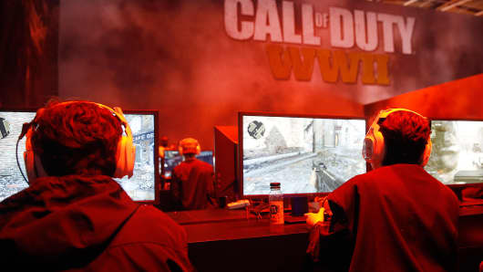 Gamers play the video game 'Call of Duty WWII' developed by Sledgehammer Games and published by Activision during the 'Paris Games Week' on October 31, 2017 in Paris, France.