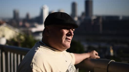 Bill Boback, 58, a retired train driver who was born and lived all is life in Pittsburgh is seen with the Downtown area of Pittsburgh, Pensylvania, in the background on June 2, 2017.