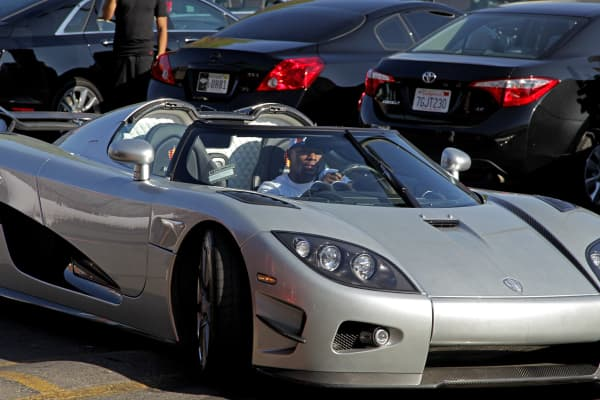 Floyd Mayweather Jr. arrives at the Mayweather Boxing Club in his new $4.8 million Koenigsegg CCXR Trevita car for a workout on August 26, 2015 in Las Vegas.