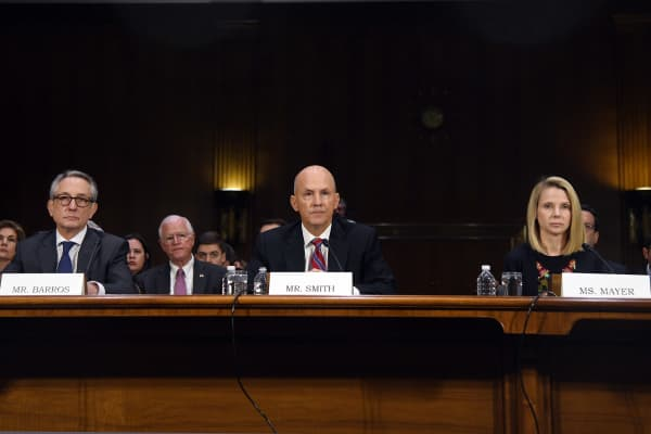 Paulino do Rego Barros, interim chief executive officer of Equifax, from left, Richard Smith, former chief executive officer of Equifax and Marissa Mayer, former chief executive officer of Yahoo!, testify during a 2017 Senate hearing on corporate hacking incidents.