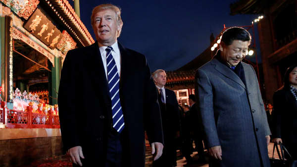President Donald Trump and China's President Xi Jinping leave after an opera performance at the Forbidden City in Beijing, China, November 8, 2017.