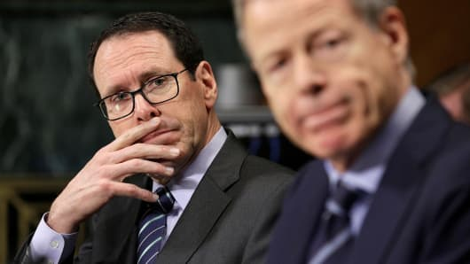 Chief Executive Officer of AT&T Randall Stephenson (L) and Chairman and Chief Executive Officer of Time Warner Jeffrey Bewkes listen to testimony before the Senate Judiciary Committee Antitrust Subcommittee hearing on the proposed deal between AT&T and Time Warner in Washington, U.S., December 7, 2016.