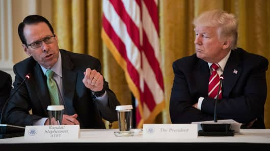 President Donald Trump listens to AT&T CEO Randall Stephenson during the 'American Leadership in Emerging Technology' event in the East Room of the White House in Washington, DC on Thursday, June 22, 2017.