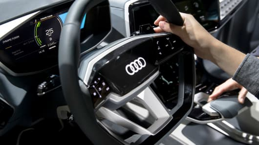 A visitor holds a steering wheel of the Audi Elaine vehicle in the Audi AG booth during the Tokyo Motor Show at Tokyo Big Sight on October 25, 2017 in Tokyo, Japan.