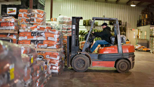 A crop consultant uses a forklift to sort Monsanto DeKalb brand seed corn at the Crop Production Services warehouse in Manlius, Illinois.