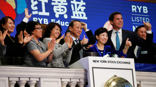 Chimin Cao, Co-Founder and Chairman for RYB Education Institution and Yanlai Shi, Co-Founder and CEO for RYB Education Institution, ring the opening bell together to celebrate their company's IPO at the New York Stock Exchange (NYSE) in New York, September 27, 2017.