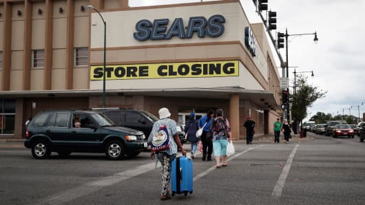 A sign announcing the store will be closing hangs above a Sears store in Chicago, Illinois.