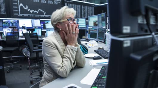 A trader monitors financial data at the Frankfurt Stock Exchange in Germany.
