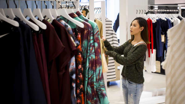 A shopper browses dresses in a Nordstrom store in downtown Vancouver, British Columbia.