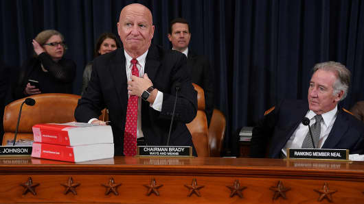 House Ways and Means Committee Chairman Kevin Brady (R-TX) (L) sets down a copy of the current tax code as he and ranking member Rep. Richard Neal (D-MA) prepare for the first markup hearing of the proposed GOP tax reform legislation in the Longworth House Office Building on Capitol Hill November 6, 2017 in Washington, DC.
