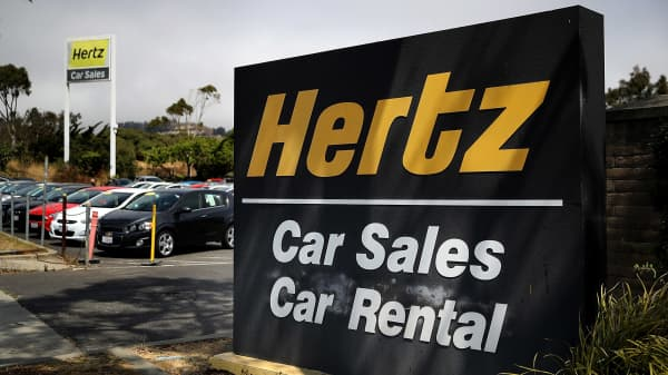 A sign is posted in front of a Hertz car sales and rental car office on August 8, 2017 in South San Francisco, California.