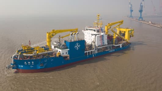 China's largest cutter-suction dredger, the Tian Kun Hao, takes water on November 3, 2017 in Qidong, Jiangsu Province, China. Measuring 140 meters long, the vessel is capable of dredging 6,000 cubic meters per hour. It can dig up to 35 meters deep and boasts a maximum conveyance of 15,000 meters.