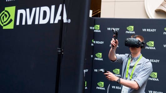 Rodolfo Campos uses a virtual reality headset during a NASA Hybrid Reality Lab demonstration at the NVIDIA GPU Technology Conference which showcases artificial intelligence deep learning virtual reality and autonomous machines in Washington DC Novem