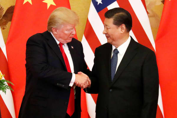 President Donald Trump and China's President Xi Jinping make joint statements at the Great Hall of the People in Beijing, Nov. 9, 2017.