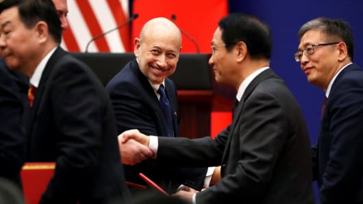 Goldman Sachs Chief Executive and Chairman Lloyd Blankfein shakes hands with other business leaders as they meet U.S. President Donald Trump and China's President Xi Jinping at the Great Hall of the People in Beijing, China, November 9, 2017.