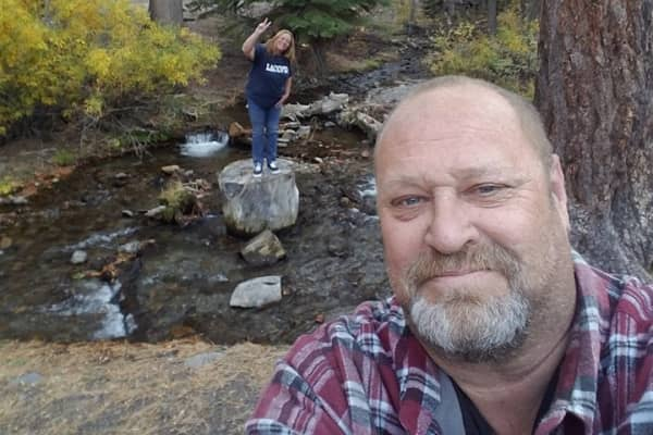 Loren Krytzer, 53, hikes with his wife Lisa.