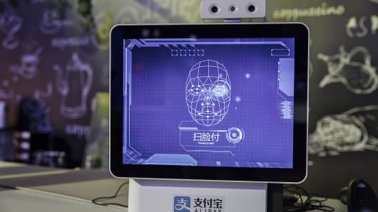 A facial recognition system on display at Alibaba's annual Singles' Day shopping event in Shenzhen, China, on Friday, Nov. 11, 2016.