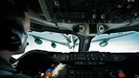 The pilot of the 747-class Boeing E-4B Advanced Airborne Command Post carefully flies the plane is it is refueled in midair by a U.S. Air Force KC-135 April 6, 2011 over the Atlantic Ocean. The E-4B is taking U.S. Defense Secretary Robert Gates from Washington to Riyadh, Saudi Arabia, where he will begin at trip to the Mideast for a series of meetings with regional leaders.