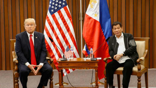 US President Donald Trump (R) speaks during a bilateral meeting with Philippine President Rodrigo Duterte on the sidelines of the 31st Association of Southeast Asian Nations (ASEAN) Summit and Related Meetings at the Philippine International Convention Center in Manila on November 13, 2017.