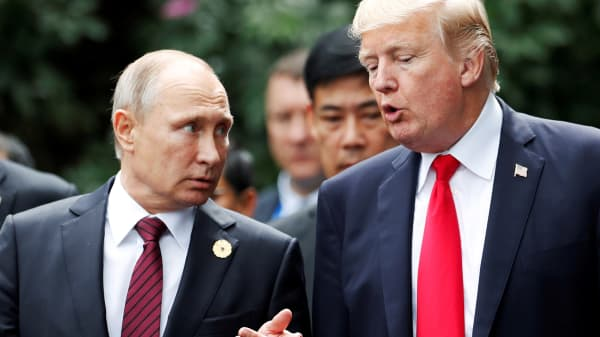 President Trump and Russia's President Vladimir Putin talk during the family photo session at the APEC Summit in Danang, Vietnam.
