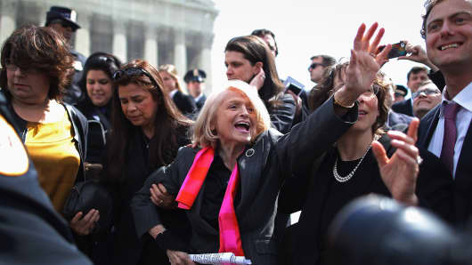 Edith Windsor (C), 83, is mobbed by journalists and supporters as she leaves the Supreme Court March 27, 2013 in Washington, DC.