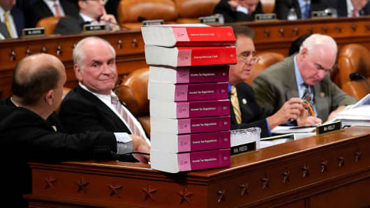 House Ways and Means Committee member Rep. Tom Reed (R-NY) keeps a stack of books that document the current federal tax code and related regulations on his desk during the first markup of the proposed GOP tax reform legislation on Capitol Hill, November 6, 2017, in Washington, DC.
