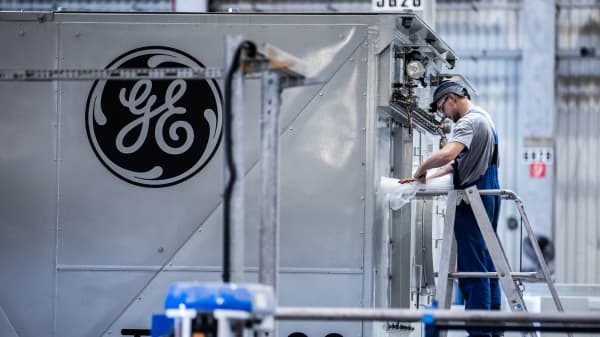 An employee unwraps turbine components inside the General Electric power plant in Veresegyhaz, Hungary.