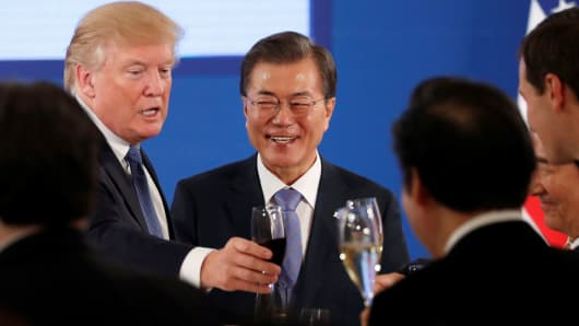 President Donald Trump shares a toast during a state dinner hosted by South Korea's President Moon Jae-in at the Blue House in Seoul South Korea