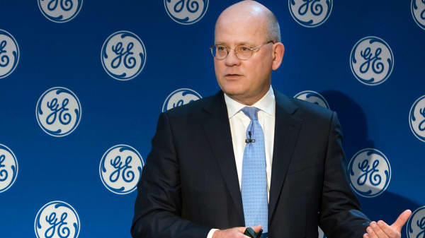 In this Monday, Nov. 13, 2017, photo provided by General Electric, GE Chairman and CEO John Flannery addresses investors at a meeting in New York. Flannery said the company is weighing the future of its transportation, industrial, and lighting businesses so that it can focus more intently on its most profitable divisions.