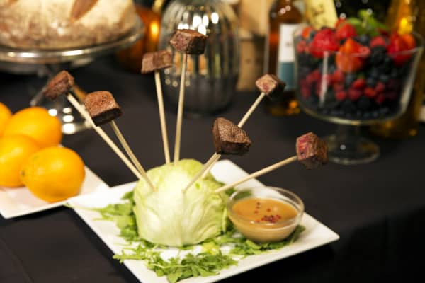 Prized Wagyu beef is on the Homestead Steakhouse permanent menu, but served here in lollipop fashion with a peppercorn au poivre dipping sauce infused with $4,800 Louis XIII cognac.