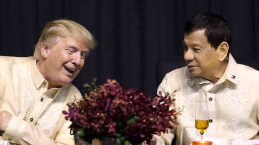 President Donald Trump with Philippines President Rodrigo Duterte during a special gala celebration dinner for the Association of Southeast Asian Nations in Manila on November 12, 2017.