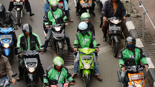 Go-Jek and other motorcycle riders on a street in Jakarta, Indonesia on Monday, March 21, 2016.