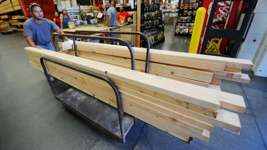 A construction worker buys lumber for home framing at the Home Depot store in Los Angeles, California.