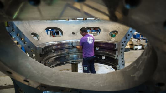 An employee of US multinational General Electric (GE) works on a gas turbine at the GE plant in Belfort, eastern France.