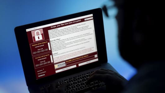 UK blames Russia for cyber says won t tolerate disruption