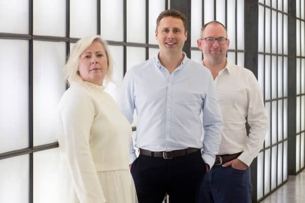Truth chief executive Mary Keane-Dawson, with COO Adam Hopkinson (right) and The Marketing Group CEO Adam Graham (center)