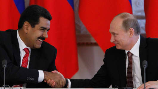 Russia's President Vladimir Putin and his Venezuelan counterpart Nicolas Maduro shake hands during a ceremony at the Kremlin in Moscow, on July 2, 2013.