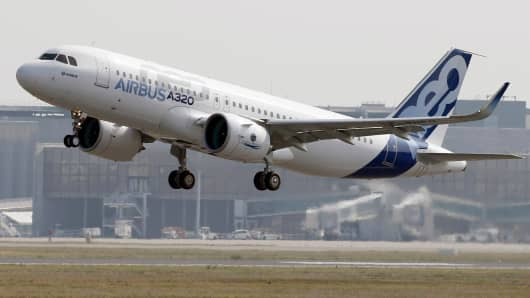 The Airbus A320neo (New Engine Option) takes off during its first flight event in Colomiers near Toulouse, southwestern France.