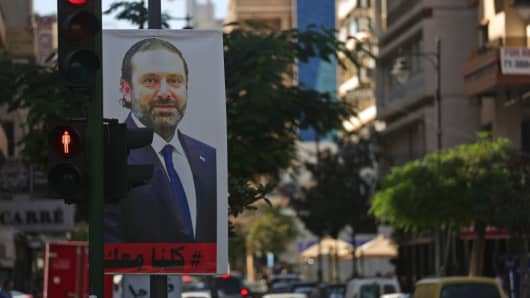A poster for Lebanese Prime Minister Saad Hariri is seen hanging on a traffic signal in Beirut's Hamra street on November 15, 2017.