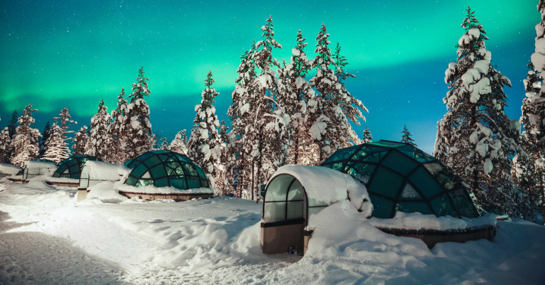 see the northern lights from a glass igloo at kakslauttanen in finland. Black Bedroom Furniture Sets. Home Design Ideas