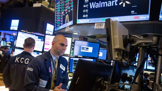Thursday's early afternoon trade: Wal-Mart, tech stocks lead Wall Street gains