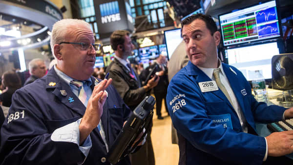 Traders work on the floor of the New York Stock Exchange during the afternoon of October 14, 2015 in New York City.