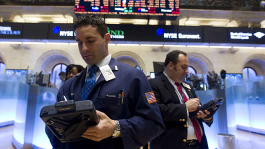 Michael Liloia, a trader with Deutsche Bank Securities Inc., left, works on the floor of the New York Stock Exchange in New York, U.S., on Tuesday, Feb. 22, 2011.
