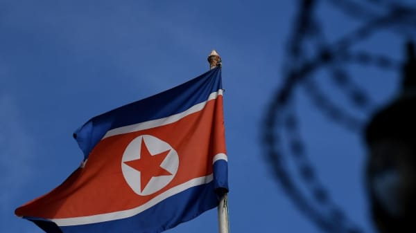 The North Korean flag is seen at mast past the barbed wire fencing of the North Korean embassy in Kuala Lumpur