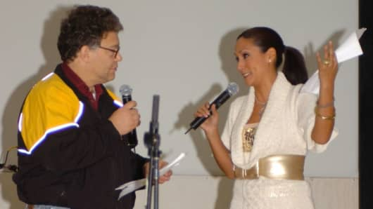 Comedian Al Franken and sports commentator Leeann Tweeden perform a comic skit on camp Thursday in front of more than 2,000 elated service members during the USO Sergeant Major of the Army's 2006 Hope and Freedom Tour.