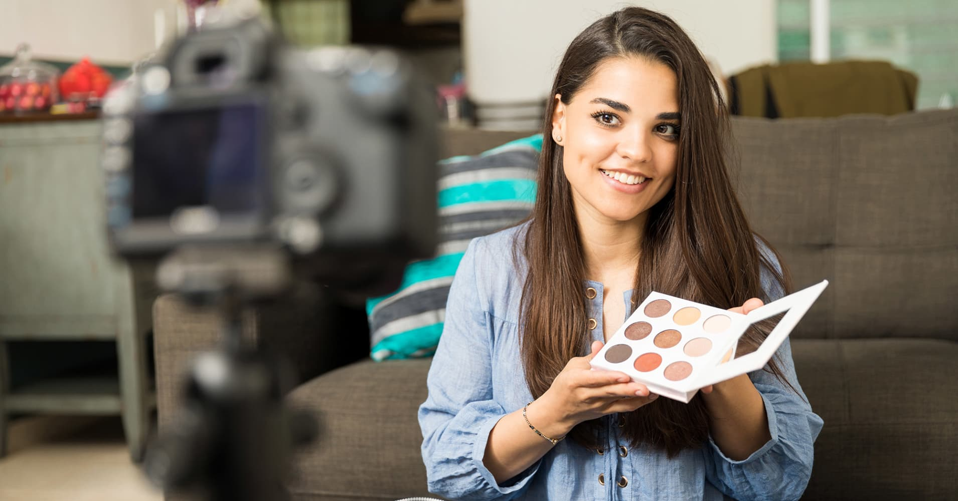 A millennial reviewing makeup on camera.
