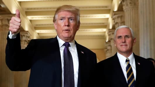 President Donald Trump gives a thumbs-up as he and Vice President Mike Pence depart the U.S. Capitol after a meeting to discuss tax legislation with House Republicans in Washington, November 16, 2017.