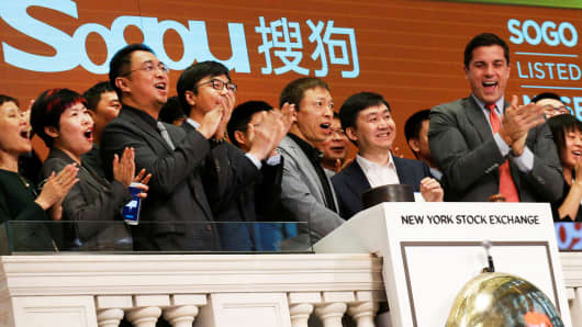CEO Xiaochuan Wang and company Chairman Charles Zhang of China-based Sogou Inc ring the opening bell to celebrate their company's IPO at the New York Stock Exchange in New York, November 9, 2017.
