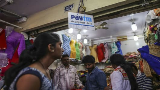 A sign informs customers they can pay using digital payment methods outside a clothing store in Bengaluru, India, on Feb. 4, 2017.