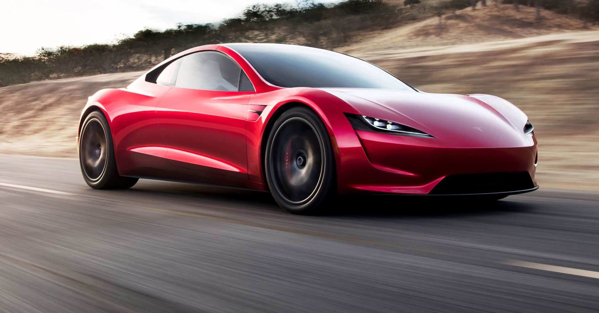 Tesla CEO Elon Musk unveils a surprise new car: A ridiculously fast Roadster